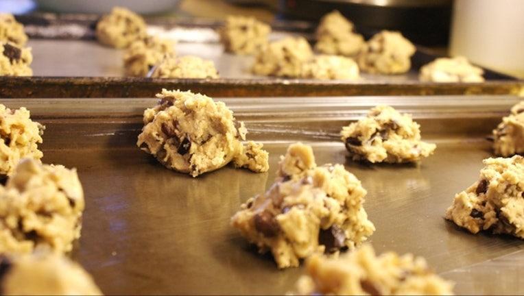 616eb2b3-Raw_chocolate_chip_cookie_dough_on_baking_sheets_1467311602811-401385.jpg