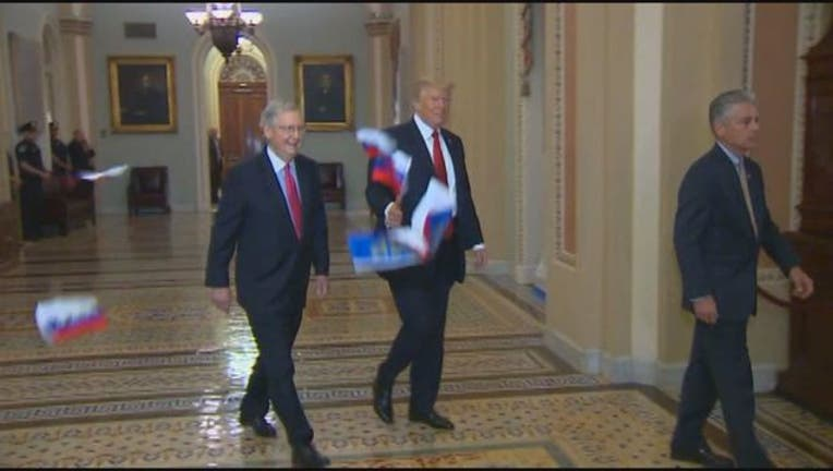 bf0e6fdb-Trump Russian Flags Tossed Capitol-401720.jpg