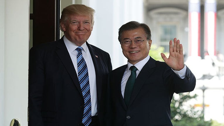 15edab49-Trump and Moon GETTY_1525111880650.jpg-403440.jpg