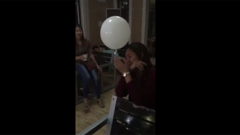 1f9ea5b5-Balloon floats to grieving mother-402970