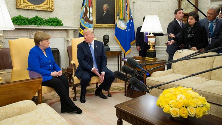 Trump and Merkel (GETTY IMAGES)-401720