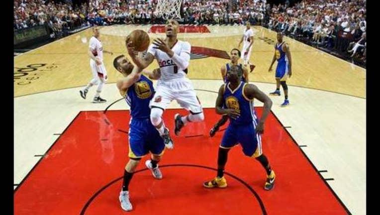 cf98b112-Warriors Trail Blazers Basketball_1462679813612