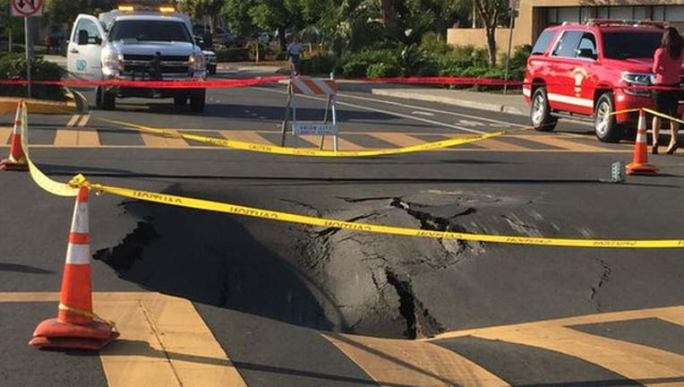 b6389dfe-Permanent repairs begin for Union City sinkhole that began in October.