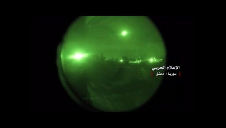 23f1e02f-syria airstrike night scope_KTVUb3fd_174.mp4_00.00.01.15_1523686481690.png.jpg