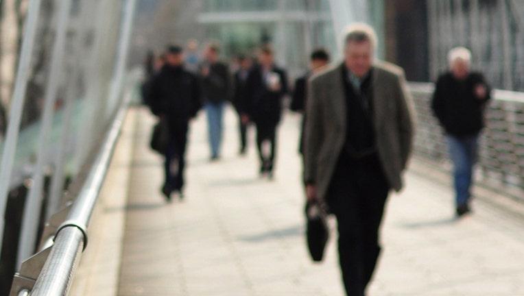 b4ef2093-walking to work  file photo_1454329900114-401385.jpg