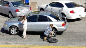 Act of kindness: Homeless man changes tire for woman stranded in middle of street