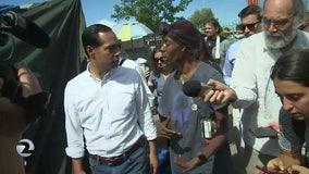 Julian Castro tours Oakland homeless encampment