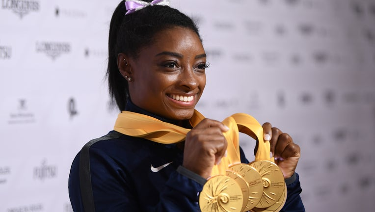 STUTTGART, GERMANY - OCTOBER 13: Simone Biles of USA poses with her Medal haul after the Apparatus Finals on Day 10 of the FIG Artistic Gymnastics World Championships at Hanns Martin Schleyer Hall on October 13, 2019 in Stuttgart, Germany. (Photo by Laurence Griffiths/Getty Images)