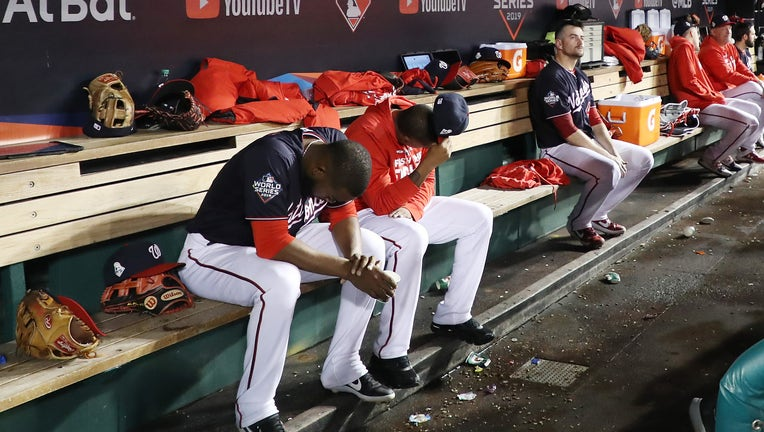 The Washington Nationals react against the Houston Astros during the ninth inning in Game Five of the 2019 World Series