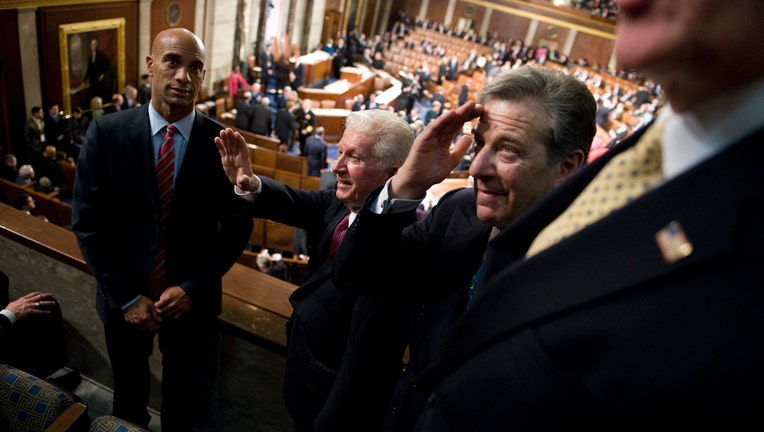 From left, Adrian Fenty, mayor of D.C., Thomas D'Alesandro, brother of Speaker Nancy Pelosi, and Paul Pelosi, husband of the Speaker, greet guests before President Barack Obama addressed a joint session of Congress in the House Chamber, February 24, 2009. (Photo By Tom Williams/Roll Call/Getty Images)