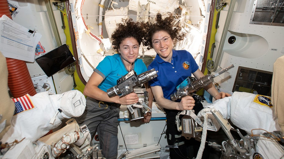 NASA astronauts Jessica Meir (left) and Christina Koch are inside the Quest airlock preparing the U.S. spacesuits and tools they will use on their first spacewalk together.