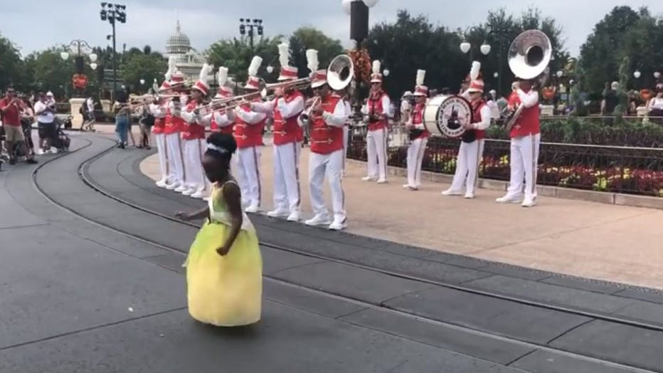 Sydney Russell, 8, busted a move with a band at Walt Disney World when she visited the park to celebrate her birthday. (Photo credit: Tiffany McKinnon Russell)
