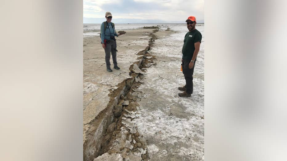 USGS-geologist-Josie-Nevitt-and-geodesist-Todd-Ericksen-collect-a-sample-from-the-fault-zone-of-the-main-rupture___Ben-Brooks-USGS..jpg