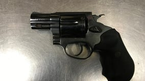Man arrested after being found asleep in his vehicle with gun on his lap