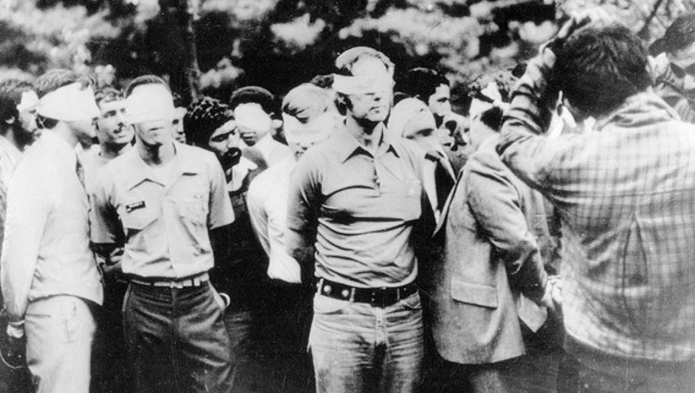 Tehran, Iran. This photo taken on the first day of occupation of the U.S. Embassy in Tehran shows American hostages being paraded by their militant Iranian captors. The picture was obtained by UPI after the FBI showed no interest. It was brought into the U.S. by an Iranian.