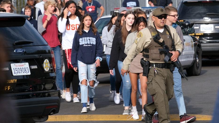 GettyImages-1-Saugus-High-School-shooting-hug.jpg