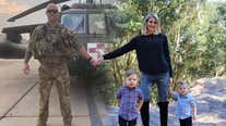 Though they are thousands of miles apart, military family unites for Christmas card