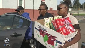 Going above and beyond: Oakland police technician gathers donations and gifts them to families in need