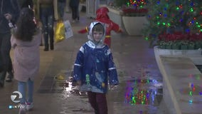 Shoppers in Walnut Creek brave the rain for holiday deals