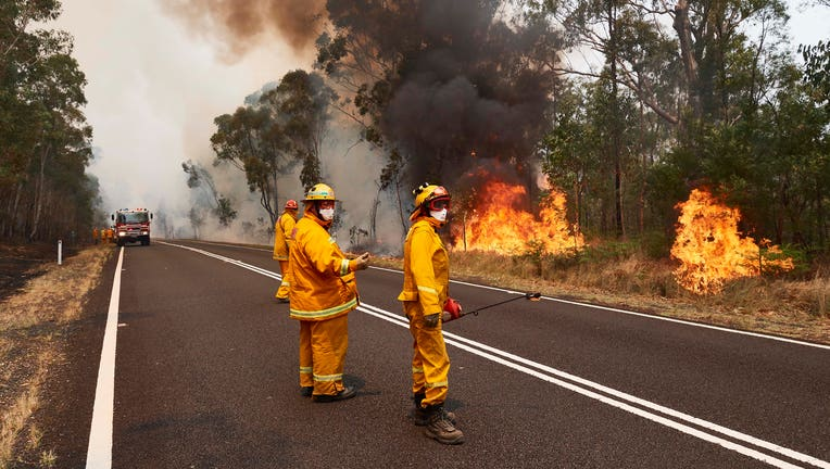 CFA Members work on controlled back burns along Putty Road on Nov. 14, 2019 in Sydney, Australia. (Photo by Brett Hemmings/Getty Images)