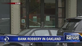 Police at scene of bank robbery in downtown Oakland