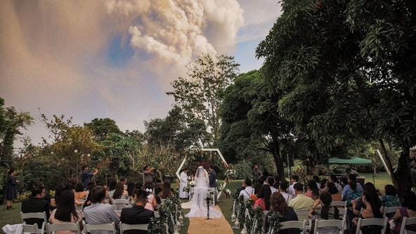 Couple's wedding pics include dramatic shot of Taal Volcano erupting