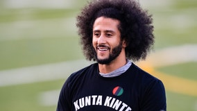 Colin Kaepernick seen handing out warm meals to families in need at shelter during Super Bowl