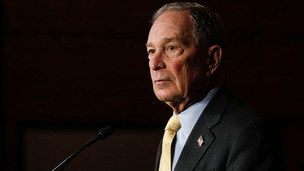 Bloomberg's Democratic rivals accuse him of trying to buy election