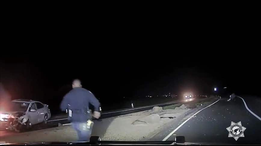 VIDEO: Elk Grove police officer saves driver from burning car