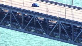 Suspect wanted after Bay Bridge crash, carjacking