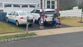Elementary students recite Pledge of Allegiance on driveways amid coronavirus pandemic