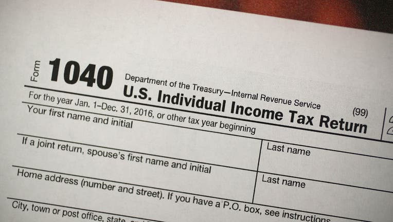 FILE - A copy of a IRS 1040 tax form is seen at an H&R Block office on Dec. 22, 2017 in Miami, Florida.