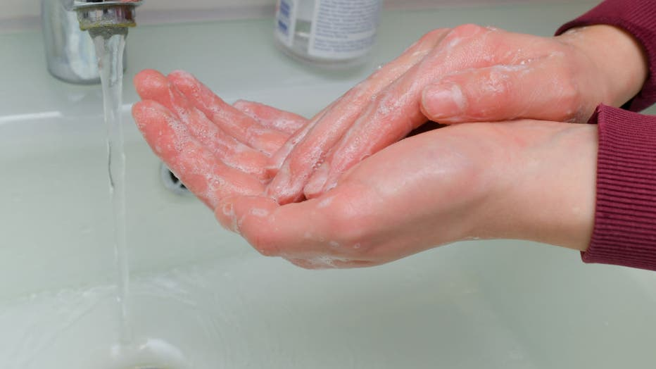 A girl washes her hands with soap and water. Hand hygiene measures are among the most important infection prevention measures. Personal hygiene, especially thorough hand washing, is particularly important as protection against the coronavirus.