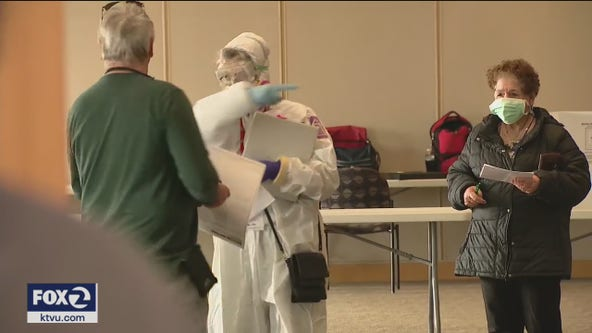 Wisconsin voters wait for hours, others stay home amid virus