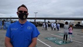 Medical personnel appreciate military jet flyover salute