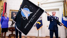 Space Force unveils flag; Trump touts 'super-duper missile'