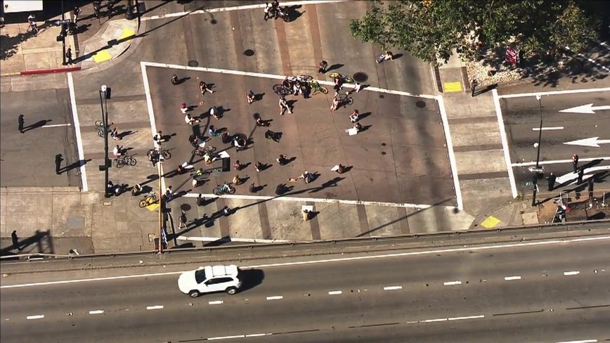 Protesters against police brutality block intersection near Oakland police headquarters