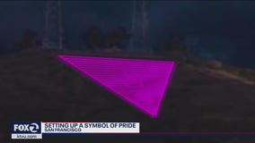 Crew prepares iconic Pride pink triangle atop Twin Peaks, but with lights