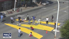 Artists paint massive message on the streets of Richmond