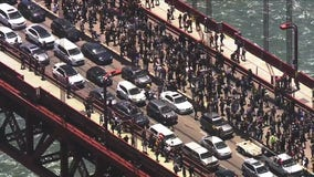 Protesters march into traffic on the Golden Gate Bridge