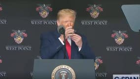 Videos of Trump walking on ramp, lifting glass with two hands put him on the defensive