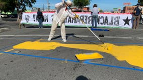 Artists paint powerful message across Richmond roadway demanding unity, change