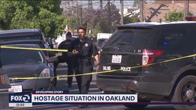 Oakland man barricaded in home with young children and rifle peacefully surrenders