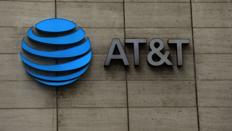FILE - The logo of AT&T outside of AT&T corporate headquarters.