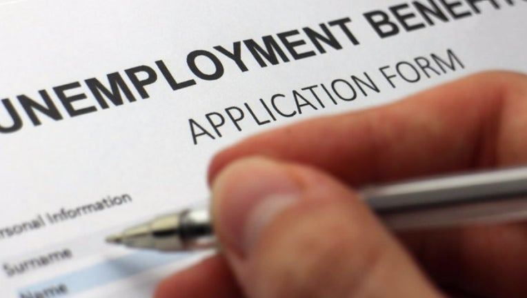 A person fills out an unemployment benefits application.