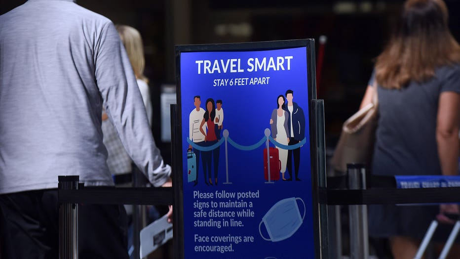A sign reminding passengers to stay 6 feet apart is seen at