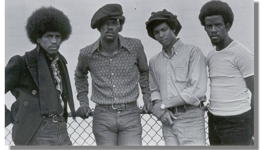 The four members of the Lumpen band stand together.