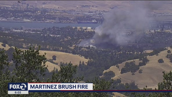 Martinez brush fire contained