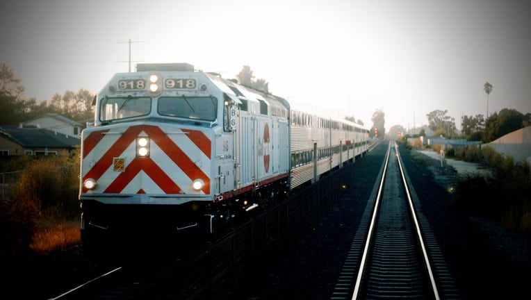 Caltrain Locomotive 918 heads south in San Mateo