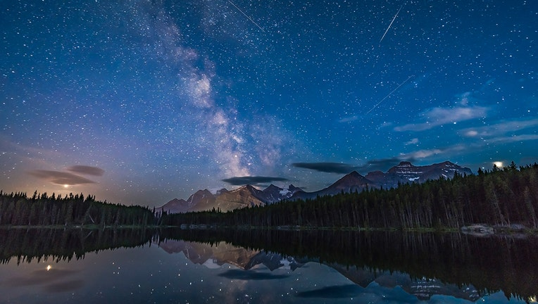 b66a1b5b-The view looking south at Herbert Lake, Banff National Park, Alberta, with the Milky Way over Mount Temple. Jupiter flanks the Milky Way on the right, while Saturn sits within the Milky Way.